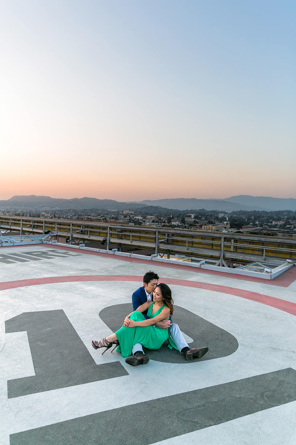 Engagement session at TENTEN Wilshire helicopter pad in Downtown Los Angeles, CA