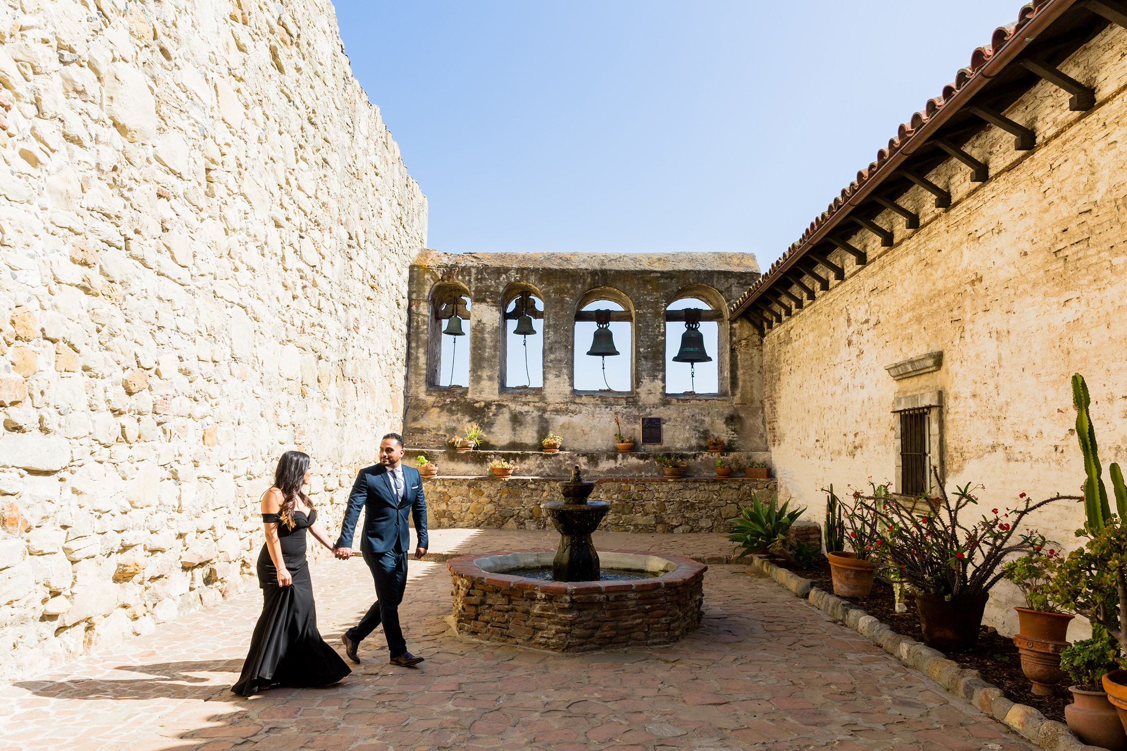 bycphotography mission san jian capistrano engagement session bells sacred garden