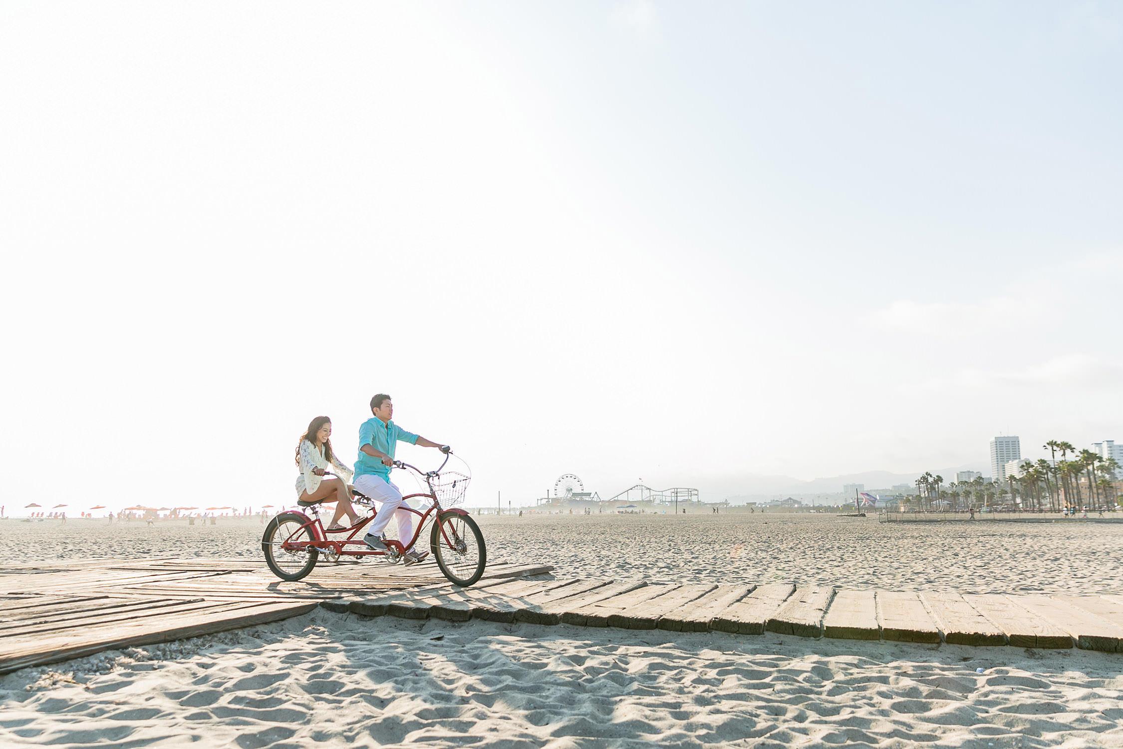 Engagement session on beach bike in Santa Monica beach, Southern California